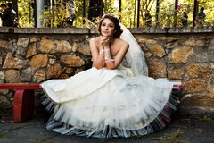 Bride sitting on bench Stock Image