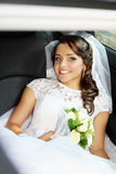 Bride sitting in the car Stock Images