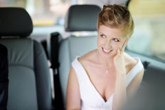 Bride sitting in a car Royalty Free Stock Photo