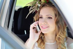 Bride sitting in a car Royalty Free Stock Images