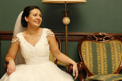 Bride sitting on the chair Royalty Free Stock Image
