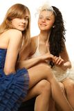 Bride sitting with envious girlfriend Stock Images