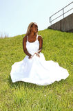 The bride sitting on the grass. Royalty Free Stock Photo