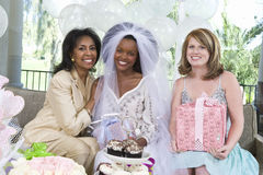 Bride Sitting With Her Mother And Friend Stock Images