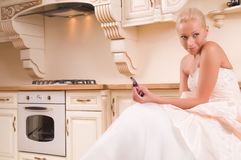 Bride sitting in the kitchen before the wedding Royalty Free Stock Photo