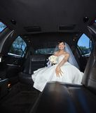 Bride Sitting in Limousine Stock Image
