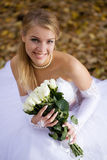 Bride sitting in a park royalty free stock photography