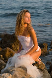Bride sitting on a rock Royalty Free Stock Images