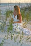 Bride Sitting on Sand Royalty Free Stock Images