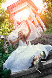 Bride sitting on the stair. Beautiful young bride sitting on the stair Stock Photo