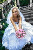 Bride sitting on the stair. Royalty Free Stock Image