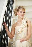 Bride Sitting on Stairs Royalty Free Stock Images