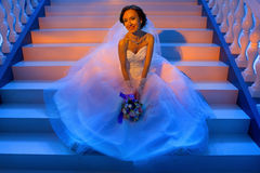 Bride sitting on the stairs Royalty Free Stock Photos