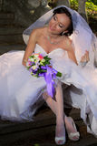Bride sitting on the stairs Stock Photography