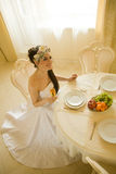 Bride is sitting at the table Stock Images