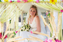 Bride Sitting Under Decorated Canopy At Wedding Stock Photos