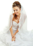 Bride sitting in wedding dress Stock Image
