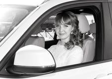 Bride sitting in white car, monochrome photo Stock Photo