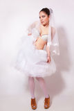 Bride in a skirt, underwear and veil Stock Image