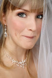 Bride with sly expression Stock Photography