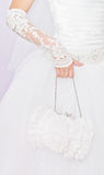 Bride with a small white handbag Stock Image