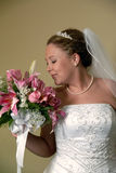 Bride Smelling Bouquet. A beautiful Bride smelling her bouquet Stock Photo