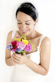 Bride smelling bouquet Royalty Free Stock Image