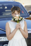 Bride Smelling Fragrance Of Flowers Stock Photography