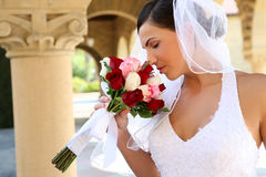 Bride Smelling Wedding Bouquet Stock Photography
