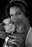 Bride Smellling Bouquet of Flowers Stock Photo