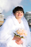 Bride smiles and holds bouquet of roses Royalty Free Stock Photography