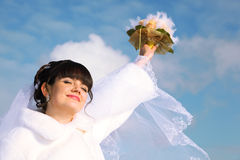Bride smiles, raised her hand with bouquet Royalty Free Stock Images