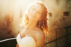 Bride smiles and shines in the light of sun Stock Photos