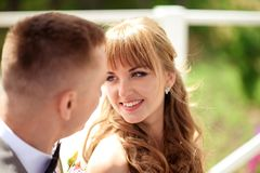 The bride smiles to the groom. Portrait royalty free stock photo
