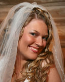 Bride smiling for the camera stock photography