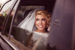 Bride smiling in the car Royalty Free Stock Image