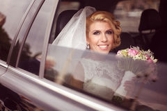 Bride smiling in the car Royalty Free Stock Photos
