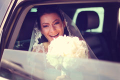 Bride smiling from a car Royalty Free Stock Image