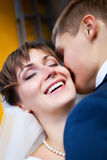 Bride smiling while groom telling her something Stock Images