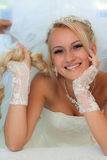 Bride smiling holding hair. Royalty Free Stock Images