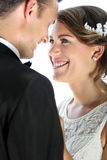 Bride smiling and staring into her groom Royalty Free Stock Photography