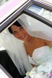 Bride smiling through window Stock Images