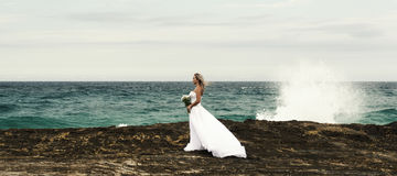 Bride at Snapper Rock beach in New South Wales. Royalty Free Stock Images