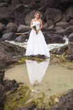 Bride at Snapper Rock beach in New South Wales. Stock Images