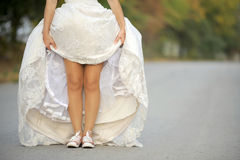 Bride in Sneakers Stock Images