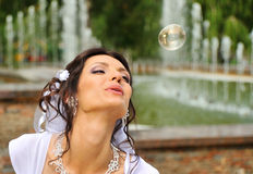 The bride and soap bubbles Stock Images