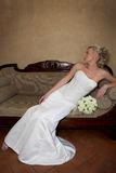 Bride Sofa. A bride sitting in a couch in her dress Royalty Free Stock Image