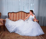 Bride on sofa Royalty Free Stock Images