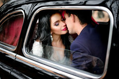 Bride with soft red lips leans to groom& x27;s face Royalty Free Stock Images