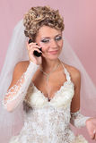 The bride speaks by phone Stock Photography